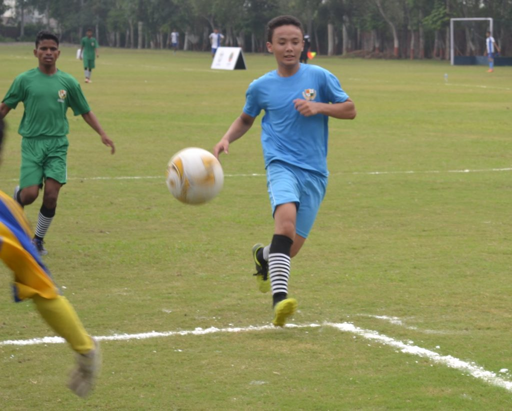 Uttar Pradesh's Gaurav Rai is in pursuit of a fourth goal in the closing stages of the Group A match against Odisha on Saturday